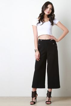 A MUST HAVE IN EVERY CLOSET: A pair black culotte pants. From cropped tees to printed camisoles, these pants are sure to make you look like the fashionista you are with it's intricate button detailing and effortless style!