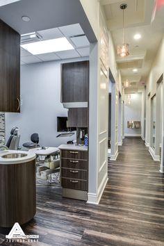 Paneled Hallways and Organic Light Fixtures. Dental Office Design by Arminco Inc.