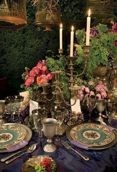 Elegant formal setting party decor outdoors flowers candles formal design dinner exterior.  Love the richness of this table.