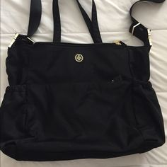 Tory Burch Nylon Travel Baby Bag Authentic. Black with gold hardware. Many zippers with many deep pockets. In excellent used condition. For specs see official site. No trades; price is firm. Thank you. Tory Burch Bags Baby Bags