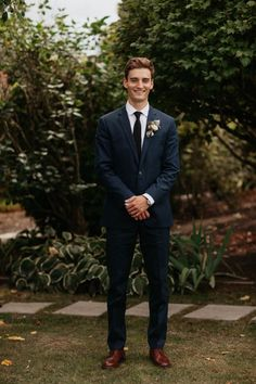 Polished groom style in navy and black with brown shoes | Image by Jordan Voth