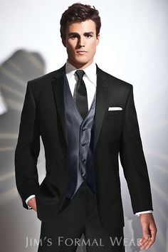 Jim's Formalwear carries slim fit tuxes unlike Men's Warehouse.  I like this one.