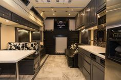 Dream bus! Alligator walls! Leather! Cow hide! et your bus conversions done at Fox Trailer Servive
