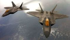 A pair of F-22 Raptors assigned to Elmendorf Air Force Base, Alaska, trail behind a KC-135 Stratotanker from McConnell Air Force Base, Kan., during an air refueling mission Aug. 23, 2012. The Stratotanker was manned by an aircrew made up of Reservists from the 931st Air Refueling Group. (U.S. Air Force photo by Senior Master Sgt. Ray Lewis)