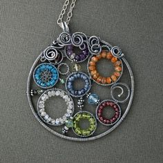 Kaleidoscope Gemstone and Silver Pendant by caroleaxium on Etsy