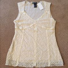 NWT! Pretty lace top New with tag! Pretty cream/ivory colored lace top. Please note this is a juniors size large. Tops