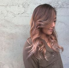 Add a hint of dusty rose pink to your more natural hair color for a little bit of fun, like this by Black Cat Salon.