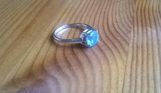 Check out this item in my Etsy shop https://www.etsy.com/uk/listing/476145552/beautiful-silver-blue-topaz-ring-simple