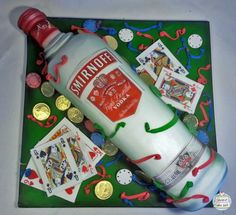 Smirnoff Vodka bottle birthday cake. For someone who enjoys a flutter and a nice drink.