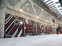 32 pieces of Melbourne street art to see before you die: Merda - QV shopping centre Melbourne.Merda is known as one of the ground breaking graffiti artists painting in Melbourne the 1980's who with his skills in graphic design took letter forms to the next level.
