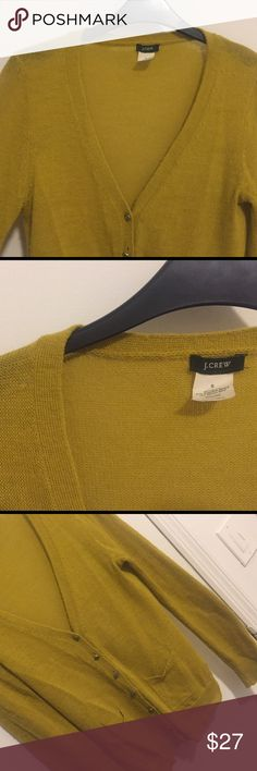 J. Crew Mustard Yellow Wool Blend Cardigan J. Crew deep V, gemstone button, mustard yellow cardigan. 45% acrylic, 37% superfine alpaca, 18% Marino wool. Two pockets, and extra button intact. Dry clean only. J. Crew Sweaters Cardigans