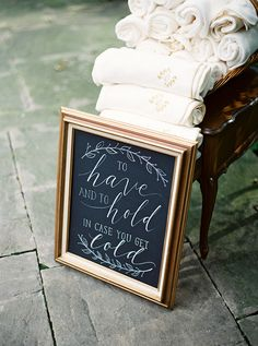 """To have and to hold, in case you get cold"" blanket display for winter wedding 