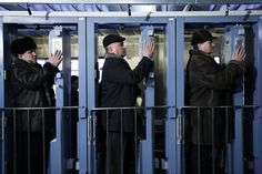Workers at the Chernobyl plant check their hands and feet for radioactive contamination at the end of the day before boarding the train home in 2009.