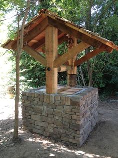 *Real* Wishing Well by Patrick of Placer Artistic Improvements. Made from Redwood and Stone Wishing Well Garden, Wishing Well Plans, Backyard Retreat, Backyard Pergola, Barbecue Garden, Garden Gates And Fencing, Garden Sink, Outdoor Furniture Plans, Water Features In The Garden