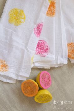Paint the colors of summer onto your bland tea towels by using citrus fruit as a stamp!