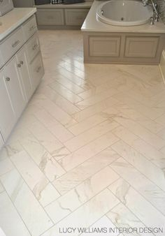 Porcelain Floor Tile - looks like marble, but without the maintenance - via Lucy Williams Interior Design