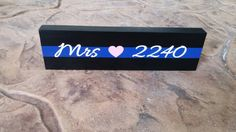Check out this item in my Etsy shop https://www.etsy.com/listing/253643242/thin-blue-line-desk-plaque-name-plate