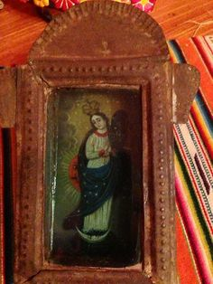 Religious saints oil painted on tin in possibly the 19th century or earlier - this is the Virgin Mary - SOLD #Mexican #Mexico #folkart #art #antique #collectible #tin #nicho #saint #virgin #vintage www.mainlymexican...