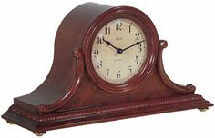 The Hermle Augustine Chiming Mantel Clock is a Tambour style clock in an Cherry finish. A beaded dentil molding surrounds the base, accenting the carved side scrolls and burl veneered front panel. The aged dial offers black Arabic numerals, spaded hour and minute hands. Quartz, dual chime movement plays Westminster or German style Bim Bam chimes, and features volume control. Programmable automatic nighttime chime shut-off option for any 8 hour period. Size: H. 8 5/8 W. 15-3/4 D. 5-1/4
