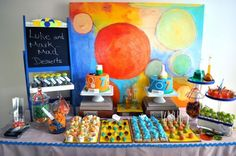 A cute mad science themed dessert table!