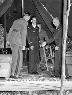 France. August 22, 1944. General Dwight Eisenhower greets French General Charles De Gaulle and his party as they arrive at his headquarters in France for a conference.