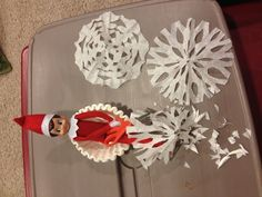 Elf on Shelf day 5 - Making coffee filter snowflakes (loving having the elf start projects/crafts I'm planning on doing with the kids!).