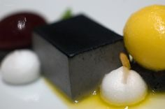 Black sesame panna cotta, sour cherry sphere w mandarin sorbet. Michael-Laiskonis