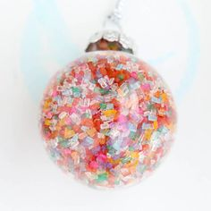 diy ornaments - filling the ball with plastic chips or edible sprinkles.