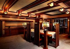 """Robie House dining room 4 corner lamps attached to table corners """"room within a room"""", builtin furniture soffit for sconces and vents. Triangular design (ship's prow)"""