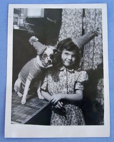 Girl and her dog having a party, 1941