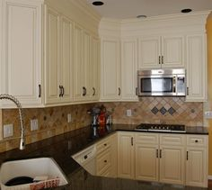 A solution to old upper cabinets with the insert that goes from the cabinet to the cieling. Add some molding and voila!