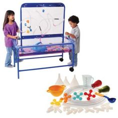 Frameworks with Water Play Accessories Kit from Constructive Playthings. Enhance your sand & water table with this accessory kit. Cut the clear plastic tubing to desired size to lace through the plastic panel. Use the various accessories and tube to get the sand or water moving.