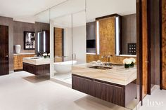 11. Spa-Like Bathrooms  Architect Martin Goldstein worked with the designer on reconfiguring the master bathroom. Custom vanities, designed by Hintgen and purchased through Minteriors, are topped with onyx by YK Stone Center and flank a steam room complete with a shower and tub.