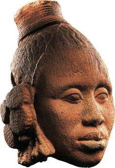 Female Head. Nigeria; Ife, 12th–14th century. Terracotta; H. 9 7/8 in. (25 cm). Provenance: Private collection, New York, 1980s; [Alain de Monbrison, Paris, 2000]; Barbier-Mueller collection, since 2005