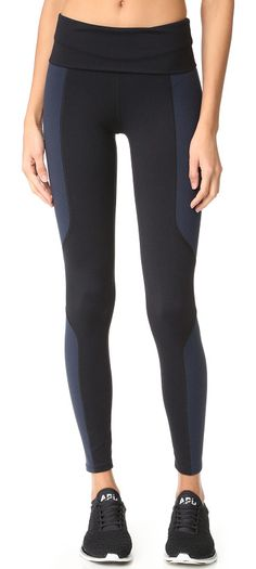 geometric leggings by LIVE THE PROCESS. These high rise LIVE THE PROCESS leggings are detailed with subtle colorblock panels. Fabric: Jersey. 90% nylon/10% l...