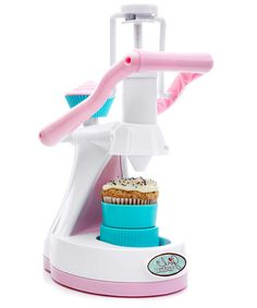 A pink and white cupcake maker toy that makes real cupcakes with icing applicator.