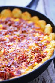 Breakfast is about to get really fun with this Tater Tot Breakfast Pizza!
