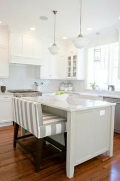 Kitchen Island - simple, minimal..love the bench.  Like the leg room under the overhang of the coutertop.