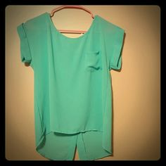 Bluish Top Blue top with light breathe able material. The buttons are sewn on and cannot be undone. Never worn but an impulse buy. Desperation for trying to put more color into my wardrobe that failed. Haha. Does not have original tag but just looking to sell. So accepting all reasonable offers. :) Tops Blouses
