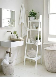 Go with an all-white decorating scheme to make your bathroom feel more spacious. A slim tapering ladder shelf unit, like this from The White Company, provides essential storage. Decorate the bathroom with potted plants and bud vases to add a natural touch Bad Inspiration, Bathroom Inspiration, Interior Inspiration, Bathroom Inspo, Bathroom Ideas Uk, Ideas To Decorate Bathroom, Interior Ideas, Interior Colors, Bathroom Styling