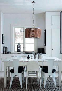 black and white dining room, white Tolix chairs