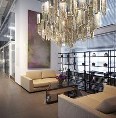 Laterneo - for a VIP lounge. Made of engraved glass prisms of bronze colour.