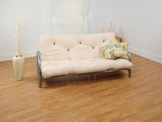 Junior Futon Sofa Bed with Faux Leather Fabric in Soft Pink http