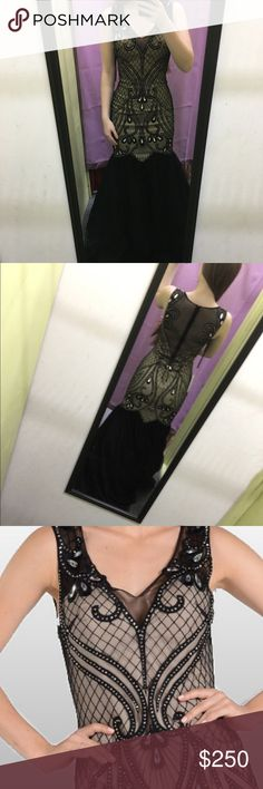 Brand new black mermaid prom dress NWT Black and nude with mermaid bottom, ornate mesh back, lined with jewels, never been worn, size 0 or XS. I am 5'4 and about 110 pounds. It's long because it hasn't been altered, but it fits my body perfectly. Dresses Prom