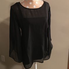 "Sheer slit sleeve blouse NWT! Gorgeous and classy! Sheer black blouse with slit sleeves and attached tank for lining.  It can be easily removed to wear something else under.  The pics don't do it justice. Measures approx. 22"" across bust and 25"" long. AB Studio Tops Blouses"
