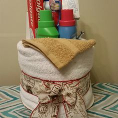 Trunk party gift,face towel,2 bath towels,gain,fabric softener,over the door hook,tooth brush,tooth paste,room freshener,soap,bleach & mouth wash