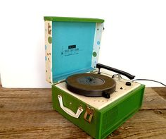 "1960's Portable Record Player... WE COULD PLAY BACKGROUND MUSIC ON A RECORD PLAYER OR FROM A MP3 THROUGH AN ""OLD LOOKING"" RADIO..."