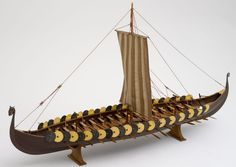 "Scale model of Viking ship ""Gokstad"", 1948.The ""Gokstad "" longboat , now preserved and on display in the Viking Ship Museum in Oslo, is a typical ""skuta"", of a type which was used for maurading raids on the British and Irish coastal towns one thousand years ago.    The Gokstad ship was found in a large burial mound at a Gokstad farm in Southern Norway in 1880. The ship had been built around 890 A.D. during the reign of Harald Fairhair ."