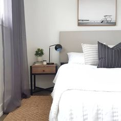 Bedroom, renovation, modern, grey bed, interior styling, jute rug, masculine bedroom, staging, white bedding, simple white walls Fixer Upper House, Jute Rug, White Bedding, White Walls, Staging, Interior Styling, Charity, Homes, Pillows