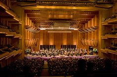 Maazel conducting the New York Philharmonic at Avery Fisher Hall. The stage designed by Architect Nicholas Buccalo.